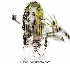 Portrait of a young woman with the effect of double exposure