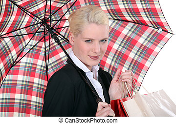 portrait of a young woman with umbrella