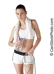 portrait of a young woman with water bottle and resistance band