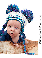 Portrait of adorable baby boy in knitted hat