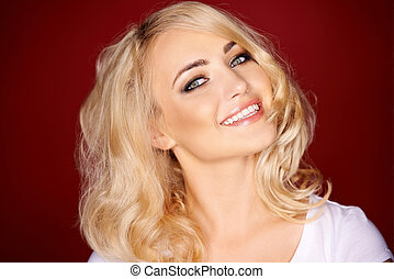 Portrait of adorable blond young woman