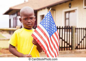 little boy holding american flag