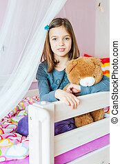 Portrait of adorable little girl in her room