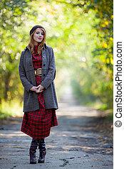 portrait of adult girl in coat