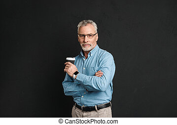 Portrait of adult man 60s with grey hair and beard posing on...