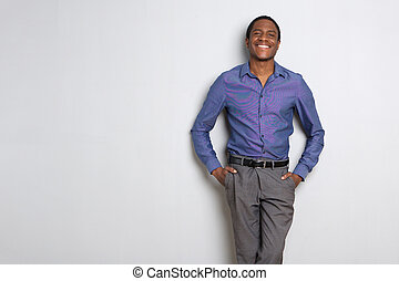 african american businessman smiling against white background
