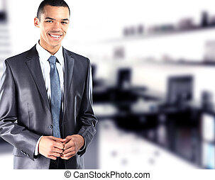 Portrait of African American businessman  with office  in background