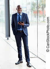 african american corporate worker holding tablet computer