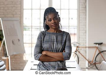 Portrait of african American female employee posing in office