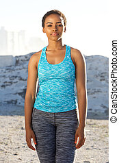 african american fitness woman standing outside