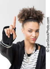 portrait of african american girl pointing up isolated on grey