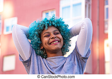 portrait of african american girl smiling happy in the city