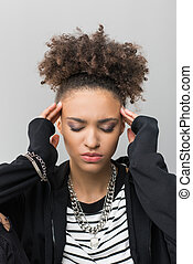 portrait of african american girl with headache isolated on grey