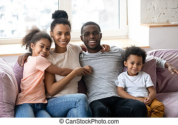 Portrait of african american happy family with two children.