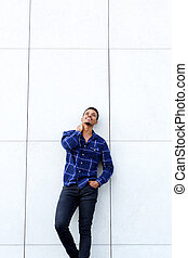 african american male fashion model smiling with blue shirt