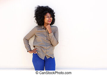 african american smiling woman standing against white background