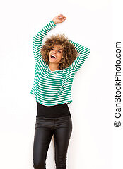african american woman laughing with arms raised