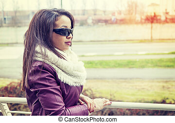 portrait of african american young girl outdoor in wintertime