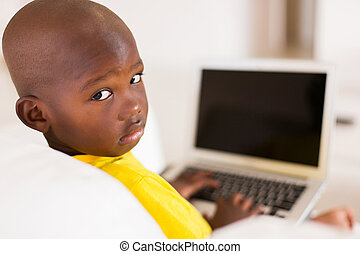 african boy with laptop computer