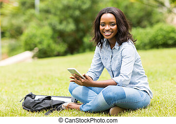 african college girl sitting at the park