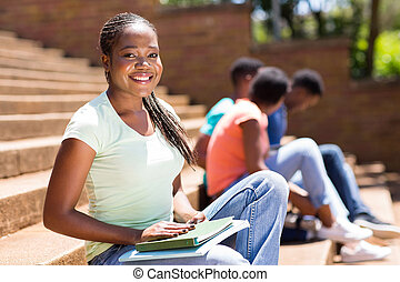 african college girl sitting on steps