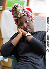 portrait of african woman wearing head scarf