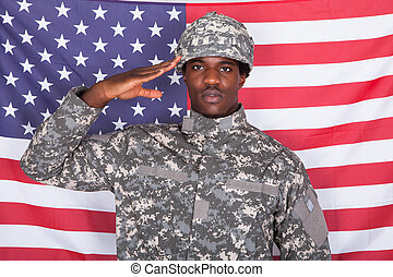 Army Soldier Saluting In Front Of American Flag - Portrait...