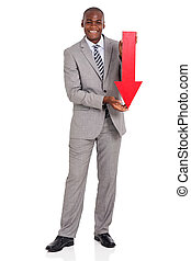 afro american businessman holding red arrow pointing down