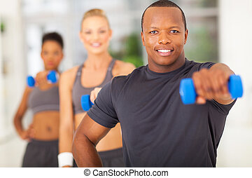 afro american man holding dumbbell