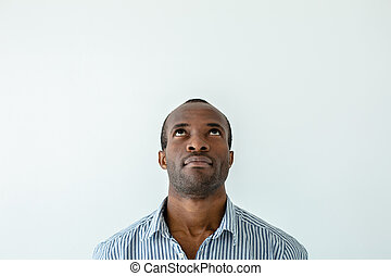 Portrait of afro american man looking up