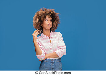 Portrait of afro girl in eyeglasses.