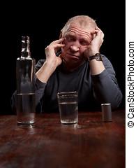 portrait of alcoholic senior man on a black background
