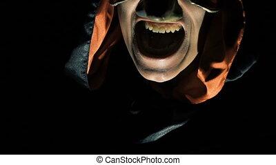 Portrait of alight vampire face scaring at night