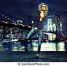Portrait of alluring lady over the night city