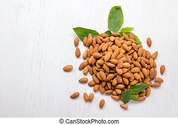 almonds in heap isolated on white