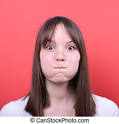 Portrait of amazed girl against red background
