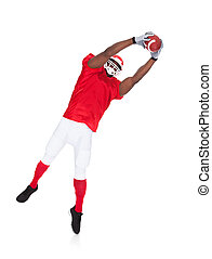 American Football Player Catching Rugby Ball