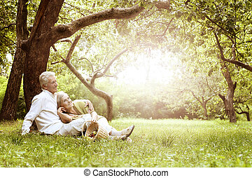 Amusing old couple on picnic - Portrait of Amusing old...