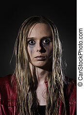 portrait of an abused woman vertica