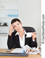 Portrait of an accountant checking receipts in her office