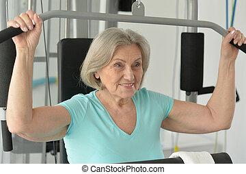smiling senior in gym