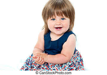 Portrait of an adorable baby girl sitting up