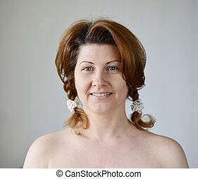 Portrait of an adult woman with bare shoulders