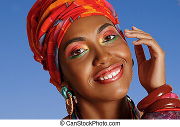 Portrait of an African American Black Woman smiling on a blue background