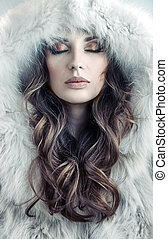 Portrait of an alluring, young lady winter