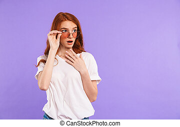 Portrait of an amazed young girl in sunglasses