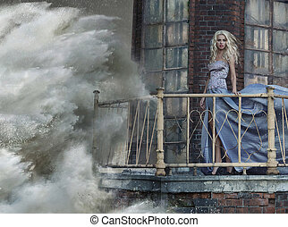 Portrait of an amazing woman standing on lighhouse during the st