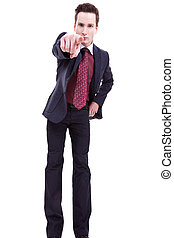 young business man in suit pointing at you