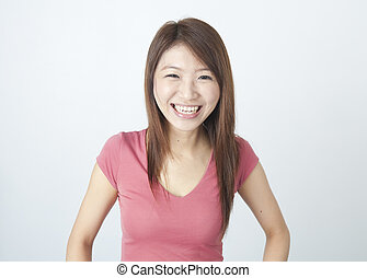 laugh - portrait of an asian girl laughing in joy