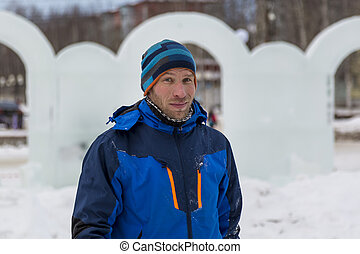 Portrait of an assembler in a blue jacket